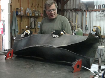 Artist Kevin Caron working on his contemporary art sculpture Sheleen