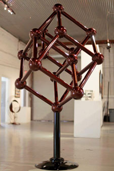 Tesseraction, a kinetic contemporary art sculpture by Kevin Caron