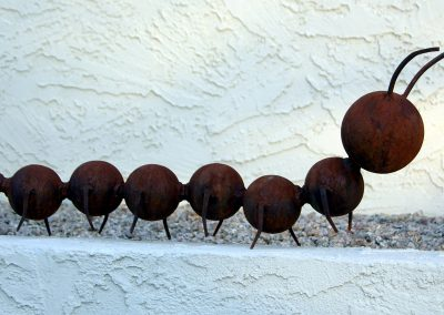 Harry & Friends, steel garden caterpillars by Kevin Caron.