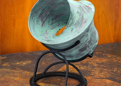Oculum, a patinated resin contemporary art sculpture by Kevin Caron