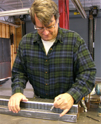 Sculptor Kevin Caron working on a new sculpture
