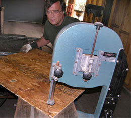 Sculptor Kevin Caron working on the window for Cruisin', a sculptural door