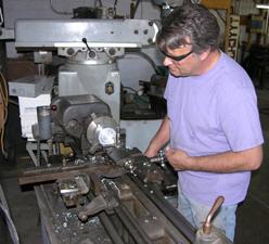 Sculptor Kevin Caron using his metal lathe