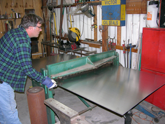 Artist Kevin Caron cutting aluminum for a new public art commission