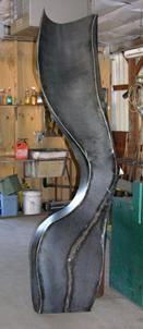 A weathering steel fine art sculpture by Kevin Caron