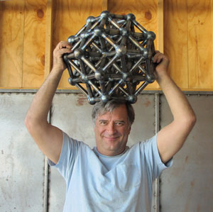 Artist Kevin Caron with the octahedron shortly after he finished welding it