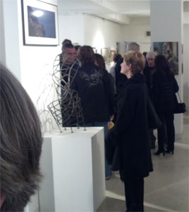 A visitor to the show in New York contemplates Cyclone, a fine art sculpture by Kevin Caron
