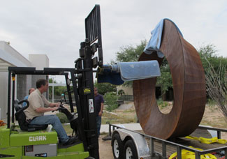 Installation of artist Kevin Caron's sculpture Wherever You Go, There You Are at Pima Community College East Campus