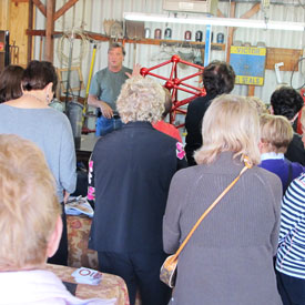 Artist Kevin Caron telling Art A'faire members about his sculpture Tess.