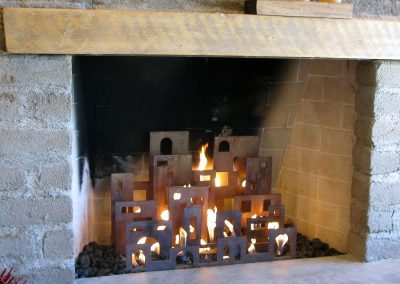 Urban Pueblo, a commissioned contemporary gas fireplace sculpture, in situ - Kevin Caron