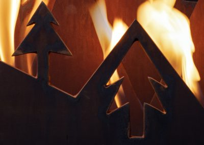 Snowy Peaks, a steel fireplace sculpture designed by Kevin Caron - Kevin Caron